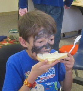 Enjoying face painting and fresh butter
